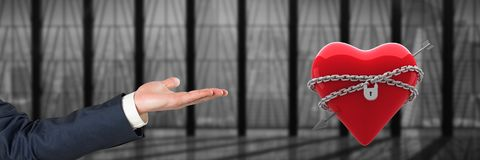 open hand and heart locked in chains by office window Stock Image