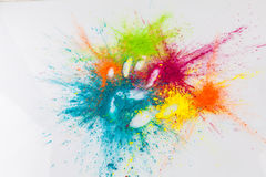 Open hand imprint in colorful Holi powder Stock Photos