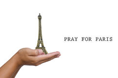 Open hand with a model the Eiffel Tower and have word pray for paris. Royalty Free Stock Images