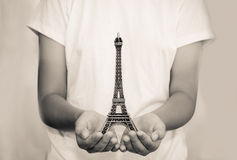 Open hand with a model the Eiffel Tower - tone vintage. Stock Photography