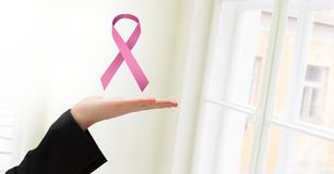 Open hand with pink ribbon for breast cancer awareness Royalty Free Stock Image