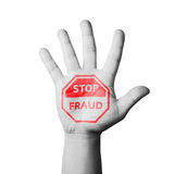 Open hand raised, Stop Fraud sign painted Stock Photos
