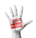 Open hand raised, Stop Greenhouse Effect sign painted Stock Photos