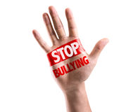 Open hand raised with the text: Stop Bullying isolated on white background Stock Photo
