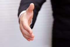 Open hand ready to seal a deal. A business man with an open hand ready to seal a deal Royalty Free Stock Photography