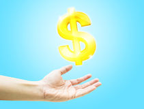 Open hand with shining dollar sign on light blue background Stock Photography