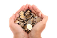 Open hand showing several euro coins isolated. Detailed shot of a hand holding some amount of euro coins isolated on pure white background Stock Photography