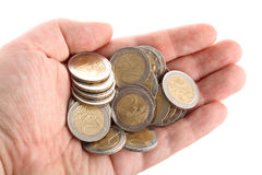 Open hand showing several euro coins isolated. Detailed shot of a hand holding some amount of euro coins isolated on pure white background Royalty Free Stock Photos