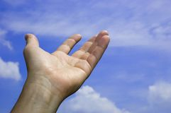 Open hand in the sky Royalty Free Stock Images