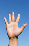 Open hand on sky background Stock Images