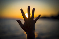 Open Hand Sun Sea Stock Photos