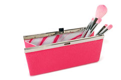 Open handbag with cosmetic brushes Stock Image