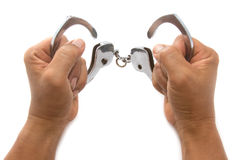 Open Handcuffs with hand Royalty Free Stock Photo