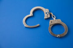 Open handcuffs with key Stock Photos