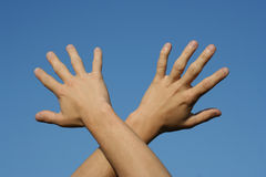 Open hands. On the blue sky Royalty Free Stock Photos
