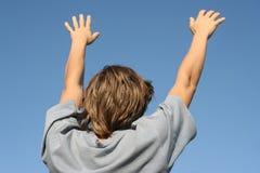 Open hands. On a blue sky Stock Photos
