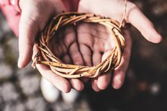 Open hands with branches wreath royalty free stock photos