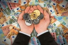 Open hands with crypto currency coins royalty free stock photo