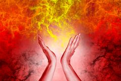 Open hands with with full of energy. Red chakra concept stock illustration