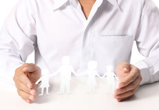 Open hands and Group of paper chain people Stock Photos