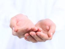 Open hands of a man. On background Royalty Free Stock Photos