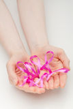 Open Hands with Pink Ribbons Stock Image