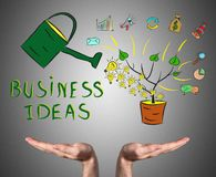 Business ideas concept sustained by open hands. Open hands sustaining business ideas concept Stock Images