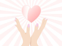 Open hands up with heart Stock Images