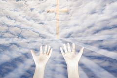 Open hands worship with cross and radius in the sky stock photography