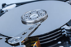 Open hard disk drive inside cylinder plates and head blue macro close up Royalty Free Stock Photos