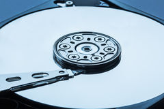 Open hard disk drive inside cylinder plates and head blue macro close up Stock Photos