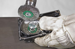 Scrubbing a hard disk. Open hard disk gets scrubbed Royalty Free Stock Photos