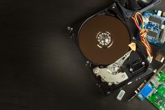 Open hard drive on a black wooden background. Production of computers. Electronics store. Backing up data on your computer. Royalty Free Stock Photos
