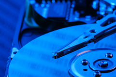 Open hard drive in blue light Stock Photo