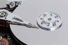 Open hard drive with magnetic disk and writing head Stock Photo