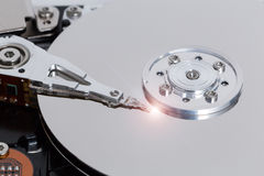 Open hard drive with magnetic disk and writing head Royalty Free Stock Photos