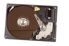 Open hard drive on a white background. Production of computers. Electronics store. Backing up data on your computer. Modern technology. Place for your text Royalty Free Stock Photography