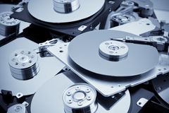 Open hard drives in bulk. Blue toned image Royalty Free Stock Photo