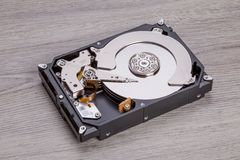 Open harddisk on wood desk Royalty Free Stock Photos