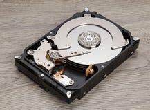 Open harddisk on wood desk Royalty Free Stock Photography