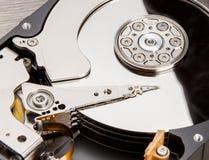 Open harddisk on wood desk Royalty Free Stock Image