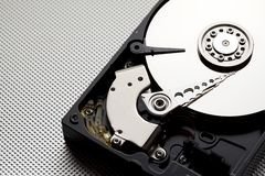 Open hdd drive on metal background. Open hdd drive on green metal background Royalty Free Stock Photo