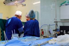 Open heart cardiac bypass surgery operation room soft focus. Open heart cardiac bypass surgery in operation room soft focus royalty free stock photo