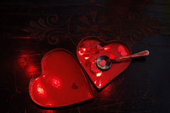Open heart metal box with small confetti hearts Stock Photo