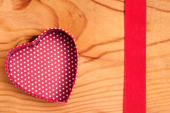 Open heart and red ribbon Stock Photo