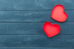 Heart and gift boxes over wooden background. Flat lay royalty free stock images