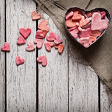 Open heart shaped gift box with heap of hearts Stock Photo