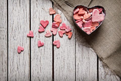 Open heart shaped gift box with heap of hearts Stock Photography