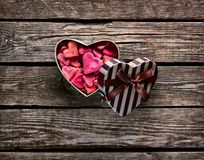 Open heart shaped gift box with heap of small Stock Image