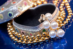 Open heart shaped jewel box with pearl earring Royalty Free Stock Image